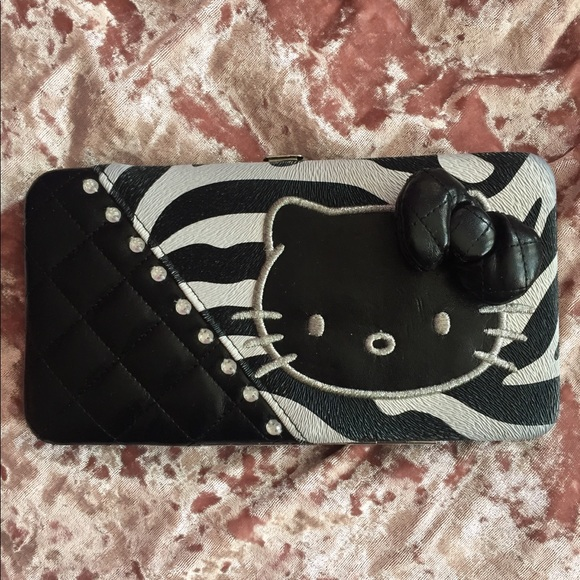 3597fca72 Loungefly Hello Kitty black clasp wallet. M_5a84b2122ae12fa285fb303b.  M_5a84b21605f4304f250cd01b. M_5a84b2183b1608e682c770e7.  M_5a84b21b05f4303b700cd025